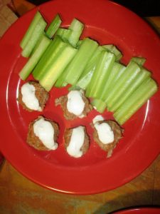 Buffalo chicken bites with blue cheese and celery sticks