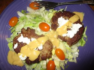 goat cheese turkey burger on a salad