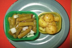 containers of potato-green bean salad