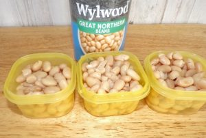 White beans in yellow containers