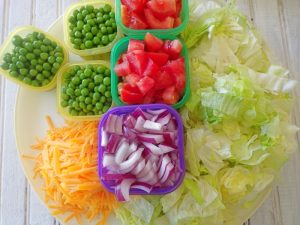 classic 7 layer salad ingredients prepped