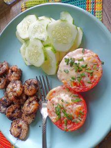 broiled parmesan tomatoes plated with shrimp